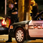 Police officers stand ready at a crime scene Friday, April 19, 2013, in Watertown, Mass. A tense night of police activity that left a university officer dead on campus just days after the Bo …