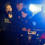 Police officers work a crime scene Friday, April 19, 2013, in Watertown, Mass. A tense night of police activity that left a university officer dead on campus just days after the Boston Marat …