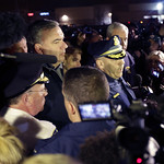 Officials brief the media on a standoff in Watertown, Mass., Friday, April 19, 2013. Authorities say one of two suspects in the Boston Marathon bombing is dead and a massive manhunt is under …