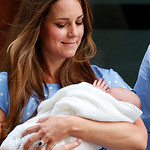 Kate, Duchess of Cambridge looks down as she holds the Prince of Cambridge, Tuesday July 23, 2013, as she poses for photographers outside St. Mary's Hospital exclusive Lindo Wing in London w …