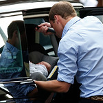 Britain's Prince William places carefully the Prince of Cambridge into a car, Tuesday July 23, 2013, as they leave St. Mary's Hospital exclusive Lindo Wing in London where the Duchess gave b …