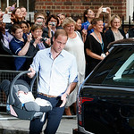 Britain's Prince William carries his son the Prince of Cambridge into a car outside St. Mary's Hospital exclusive Lindo Wing in London, Tuesday July 23, 2013 where his wife, Kate, the Duches …