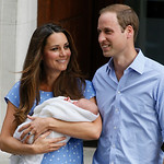Britain's Prince William, right, and Kate, Duchess of Cambridge hold the Prince of Cambridge, Tuesday July 23, 2013, as they pose for photographers outside St. Mary's Hospital exclusive Lind …