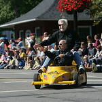 Big Chuck and Little John ride in the 40th Annual Woolly Bear Festival in Vermilion.