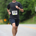 David Hathaway of Elyria on Crocker Road with just over three miles to go to his victory in the 40 to 44 age group in the Columbia Station half marathon run and skate. photo by Ray Riedel
