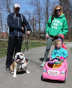 """Matt and Lori Jordan of Avon Lake walk with their daughter Ginny, age 3, and their dog """"Adrian"""" a 6-yr-old English Bulldog at the Love-a-Stray Dog Walk in Avon Lake. photo by Ray Riedel"""