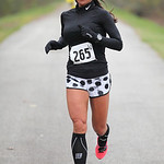 Joanie Washington is in first place in the women's 13.1 mile Inland trail half marathon. photo by Ray Riedel