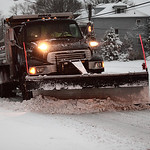 Ben Sanborn plows the slow on West Erie Avenue in Lorain by Lakeview park.  photo by Ray Riedel