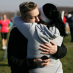 Katie Knight and Ted Wallingford embrace as Ted holds the engagement ring after his successful marriage proposal at the finish line. photo by Ray Riedel
