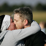 Katie Knight and Ted Wallingford kiss after the 10K race and Katie accepts his marriage proposal. photo by Ray Riedel