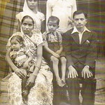 D.C. Patel, seated and barefoot, is surrounded by his family in this photo taken during a visit to India in 1950. Seated are his parents with his mother holding his little sister. Two cousin ...