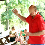 Dr. Tom Joyce, Pastor of Fields United Methodist Church in North Ridgeville, raises his hand in prayer for a blessing of all the pets everywhere during the church's second annual Blessing of …