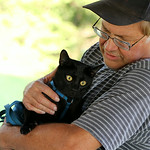 Mike Drocsin holds his newly acquired black cat during the second annual Blessing of the Pets at Fields United Methodist Church in North RIdgeville Sunday evening. ANNA NORRIS/CHRONICLE