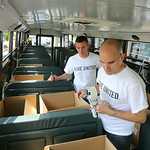 Jay Radca of Lagrange a summer intern for the United Way, works with Jeff Griffiths of the Lorain County Volunteer Connection as they box items in the United Way Fill the Bus project. The bu …