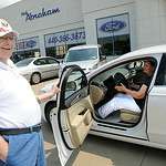 Nancy Mathewson, of Doylestown, formerly of Elyria, picks up the 2014 Ford Fusion she won with a ticket in the St. Jude Dream Home giveaway event at Nick Abraham Ford in Elyria on Aug. 7.  A …