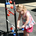 Kendra Mae Corl, 2, of Elyria, plays with a game set up at the Elyria YWCA's summer picnic on Aug. 16.  KRISTIN BAUER | CHRONICLE