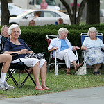 ANNA NORRIS/CHRONICLE People sit and listen to the sounds of the Vermilion Community Music Association Windjammer Big Band Sunday evening at Victory Park in Vermilion as the final concert in …
