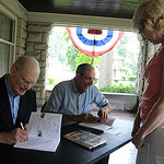 "Lorain County Historical Society secretary Robert Ebert left, and Director William Bird, co-authors of ""Elyria,"" sign copies for Patti Thomin of Elyria at The Lorain County Historical Societ …"