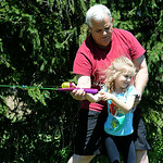 Gracie Obermiller, 6, gets her first fishing lesson from her grandfather, Gary Cooper, both of Lorain, at the pond at Forest Hills Golf Course in Elyria on Aug. 13.  STEVE MANHEIM/CHRONICLE