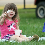 ANNA NORRIS/CHRONICLE Evelyn Fears, 2 1/2, enjoys ice cream as she listens to her dad and the other members of the Vermilion Community Music Association Windjammers Big Band perform in Victo …