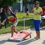Angela Wakefield and Carrie Crutcher participate in the second annual Loyolapalooza Block Party cornhole tourney on Aug. 9. KRISTIN BAUER | CHRONICLE