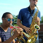 Mateo Lemieux, left, on mellophone and Noah Linden on alto saxophone play during a break at practice for the EHS Pioneer Marching Band on Aug. 15. STEVE MANHEIM/CHRONICLE