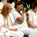 Ishikia Bennett wipes a tear during the nurses pinning ceremony on Aug. 1. KRISTIN BAUER | CHRONICLE