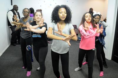 Emoni Hill, left, Sianna Napp, Kiyasia Hudson, Kaela Crawley and Khadijah Wood, members of the Steel City Dance Team, rehearse at Soulful Voices Entertainment in Lorain on Feb. 25.   STEVE MANHEIM/CHRONICLE