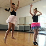 Khloe Racz, 5, left, and Bella Truxall, 7, of Elyria, learn how to jump on the first day of Ballet and Jazz Combo Class at Elyria YWCA on July 7.  The class continues through the week.   Ste …
