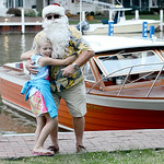 Lucie Miller, 8, of Delaware, hugs Santa during Vermilion's annual Christmas in July festivities on July 25.  KRISTIN BAUER | CHRONICLE
