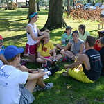 Visiting students from the Shepherd of the Valley Church, in Afton, Minn., talk in a circle at a community picnic at Oakwood Park on July, 24.  The students are on a mission trip working wit …