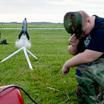 U.S. Air Force Auxiliary Cadet 2nd Lt. James Carey, 15, of Lorain, and Adam Wagner, 16, of Amherst, launch a rocket made out of a 2-liter bottle at the Lorain County Regional Airport on July …