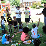 Lorain officer Jason Orellano, school resources officer with Lorain City Schools, visits children at Marshall Plaza Apartments in Lorain for an anti-drug and safety demonstration on July 11. …