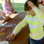 Sisters Natalie-Grace Medina, 7, and Stephanie-Rose, 10, both of Lorain, work on bracelets at a community picnic at Oakwood Park hosted by Neighborhood Alliance and Next Step Ministries on J …