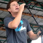 American Idol Season 10 winner Scotty McCreery performs for a free concert at Quaker Steak and Lube in Sheffield Village on July 23. Over 2,000 people attended the event sponsored by Lake Er …