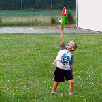 Casey Haff, 6, of Amherst runs to retrieve his rocket after participating in the U.S. Air Force Auxiliary's rocket launch experiment at the Lorain County Regional Airport on July 1. KRISTIN  …