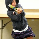 Livia Goforth, 6, of Lorain, catches a boomerang thrown by Gary Broadbent during a demonstration for kids at the Lorain Public Library Main Branch on July 28. STEVE MANHEIM/CHRONICLE