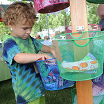 Steven Alten, 6, of Bay Village, looks through items at Emmie's Handmade clothing of Bay Village, at the ninth annual Summer Market at Veteran's Memorial Park in Avon Lake on July 25. The ma …