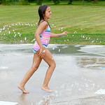 Kathleen Rader, 9, of Grafton, runs through the jets at the North Park Splash Pad in Grafton on July 22. KRISTIN BAUER | CHRONICLE
