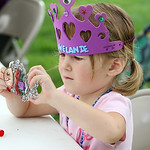 Melanie Rivera-Lough, 3, carefully colors a butterfly sun catcher during the annual Voice for Children Family Fun Day  in Ely Square in Elyria on July 20. ANNA NORRIS/CHRONICLE