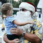 Linnea Ayala, 3, of Phoenix, Ariz., greets Santa during Vermilion's Christmas in July festivities on July 25.  KRISTIN BAUER | CHRONICLE