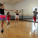 Bella Truxall, left, Adrianna Rotuno, Khloe Racz, and Alyssa Thompson learn how to jump on the first day of Ballet and Jazz Dance Combo class at Elyria YWCA on July 7.  The class continues t …