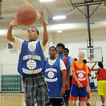 Dwayne Bonton, 13, of Elyria, takes his turn to shoot at the Reach and Rise Motivational Leadership Basketball Camp at Elyria South Recreation Center on July 15. STEVE MANHEIM/CHRONICLE