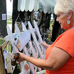 Beverly Miller of Dundee, Mich., browses through beach-related items at the ninth annual Summer Market at Veteran's Memorial Park in Avon Lake on July 25.  The market features vintage, handm …