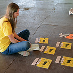 Rebecca Anacher, 17, of Brunswick, completes her dog parasites test during the dog Skill-A-Thon at the Medina County Fair. KRISTIN BAUER | CHRONICLE