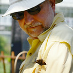 Bob Bemer, of Westlake, looks at a butterfly that landed on his shoulder at the Miller Nature Preserve on July 31.  KRISTIN BAUER | CHRONICLE