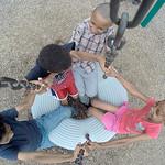 Gage Martinez,10, left, Cadence Martinez,5, Sincere Martinez, 9, and Lyric Martinez, 8, spin around and around at the West Park playground. BRUCE BISHOP/CHRONICLE