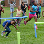 Jazmiere Whitfield, 8, is cheered on by her friends as she runs through an obstacle course on July 19.  KRISTIN BAUER | CHRONICLE