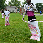 Heaven Edwards, 13, jumps across the finish line during the obstacle course set up at Kid's Day at the Lorain Metropolitan Housing Authority on July 19. KRISTIN BAUER | CHRONICLE