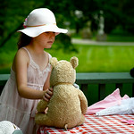Cheyenne Justice, 9, of Sheffield Township, sits her bears down for tea at Schoepfle Gardens on July 26.  KRISTIN BAUER | CHRONICLE